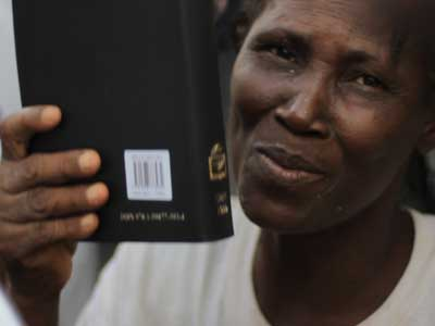 Hatian-women-gets-bible-after-receiving-Christ-and-praises-God-for-new-bible